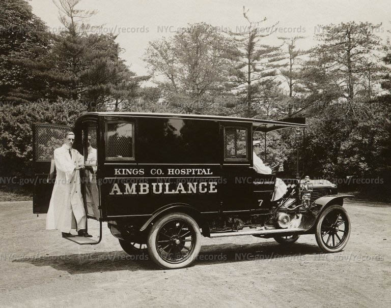 Kings County Hospital ambulance (same ambulance as above) , medical attendant in long white coat stands at rear.