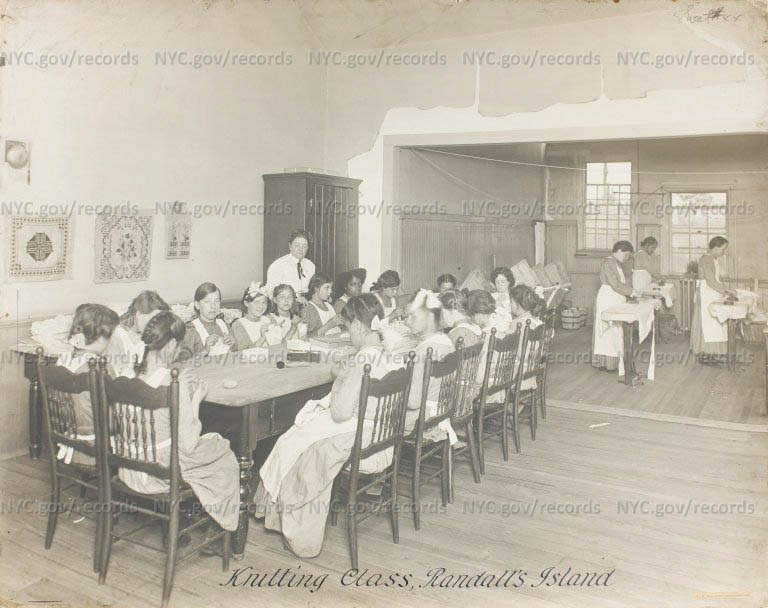 Randall's Island: Knitting Class at Children's Hospital. Older girls (or women) ironing at right.