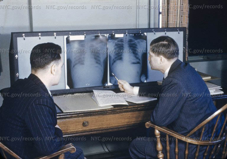 Patient and physician study lung X-Rays.