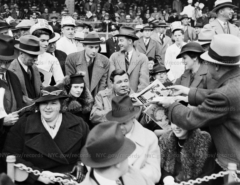 """""""World Series"""", Kate Smith and Babe Ruth in special seats in front of grandstand"""