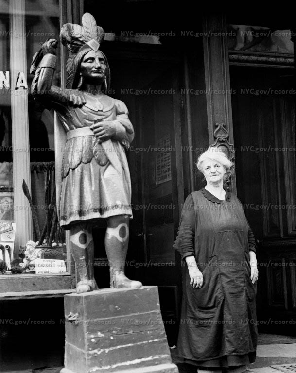 Close-up of cigar store wooden Indian, at 7th East, near 1st Avenue, with owner Brody (Folder 50)