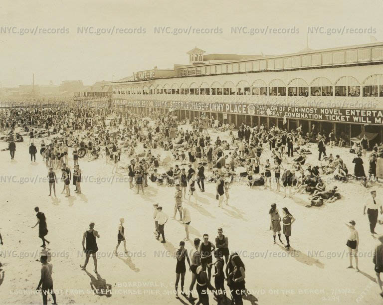Boardwalk, Coney Island looking West from Steeplechase Pier showing Sunday bathers on the beach