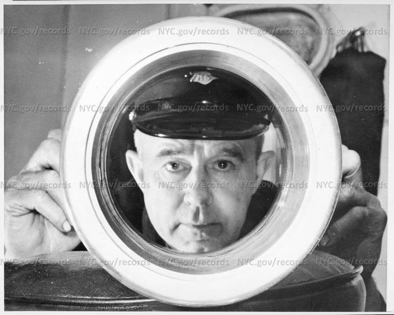 "Fireboat ""Firefighter"" - novelty shot: fireman peering through [nozzle]"
