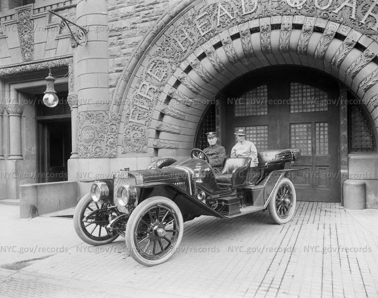 Two men in car at Brooklyn H.Q.