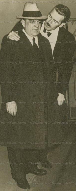 W. Arthur Cunningham with arm around shoulder of LaGuardia