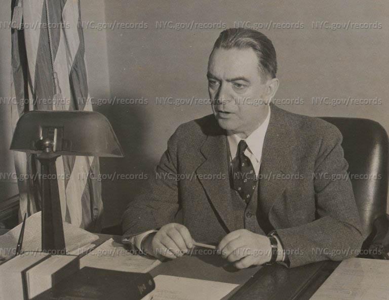 O'Dwyer at desk.
