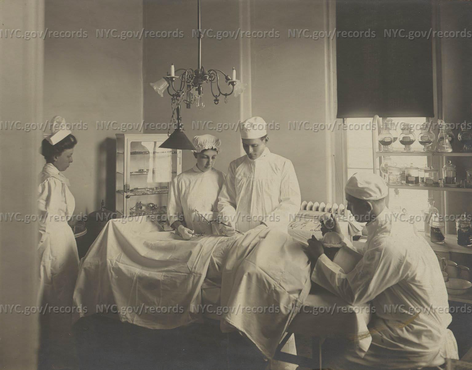 Bradford Street Hospital Operating Room: Surgeon, anesthetist, nurses, patient on table.