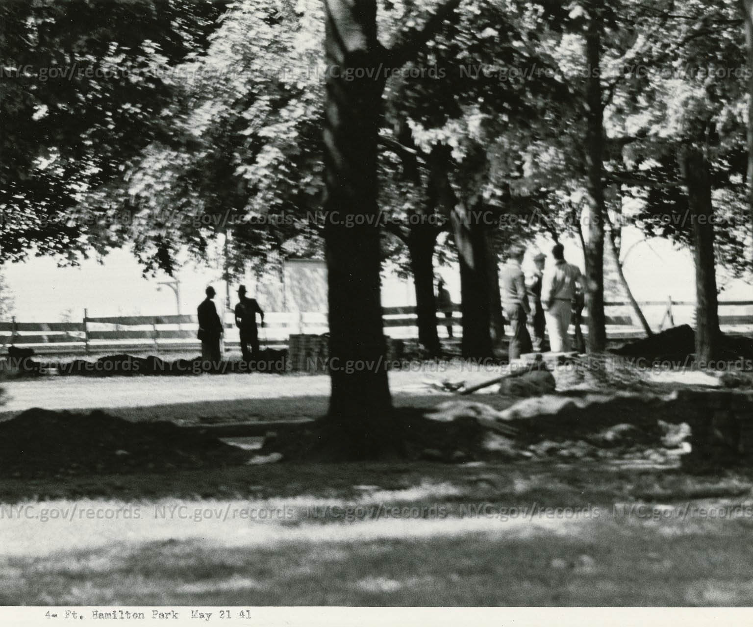Two views of workers amidst trees in Fort Hamilton Park, Brooklyn